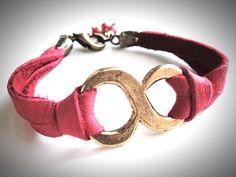 Big Brass Infinity bracelet on super soft red leather. $24, via Etsy.