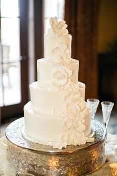Wedding Cake With Cascading Sugar Flowers | photography by http://www.brookeimages.com/