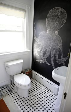 Octopus drawing on a chalkboard wall plus black and white floor tile