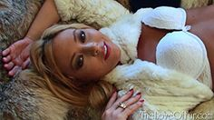 Natalia Forrest indulging in an erotic scene alone on her furry chaise lounge. Lovers of slim beautiful women, long hair, romantic lacy lingerie and sexy white stockings will love how preens herself while brushing her long hair, before sliding into the fox and lynx beneath her to roll and writhe among the long haired furs.