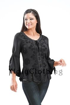 Love this in black! Heavily embroidered front-laced top with sleeve lacing -- looks very fun and flattering. With jeans or slim skirt.