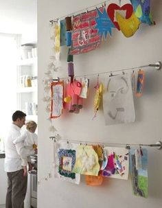 Curtain rods to hold art. | 41 Clever Organizational Ideas For Your Child's Playroom