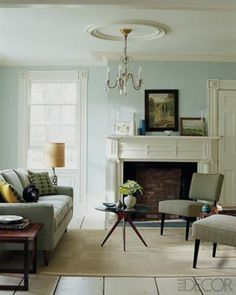 Robin's egg blue + creamy neutrals in midcentury modern living room, featured in Elle Decor