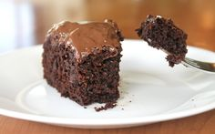 Secretly Healthy Chocolate Cake by yammiesnoshery: Made with all-purpose and whole wheat flour, brown sugar, cinnamon, cocoa powder, applesauce, and zucchini. #Cake #Chocolate #Healthy