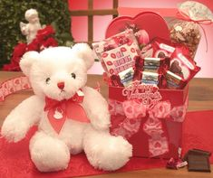 This adorable white teddy delivers A Big Kiss For You in this Valentines Day Care package! A bag full of Hershey's kisses plus other Valentine chocolates and cream filled hearts convey your message of love in the sweetest way! Send the A Big Kiss For You Valentines Day Care Package to the loves in your life!  SHOP NOW: www.KimsLabellabaskets.com