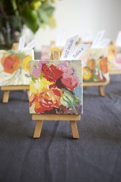 Love this idea for an art themed event/wedding - mini canvas artwork used as escort cards and then favours for the guests afterwards
