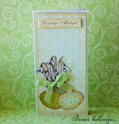 handmade Easter card ... tall and thin format ... die cut eggs ... flower image stamped, cut out and popped ... lovely printed papers ...