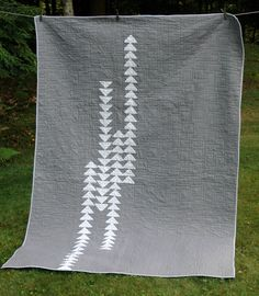 Modern Quilt in Gray and White Flying Geese Pattern.