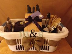 For a beautiful and personalized wedding gift: order items from the bride & grooms registry and then decorate a laundry basket with their initials and burlap! Lovely presentation!
