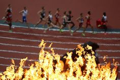 Olympic runners and Olympic flames