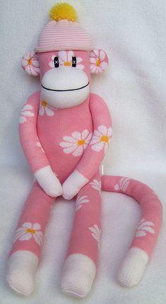 a pink daisy sock monkey...you gotta smile!