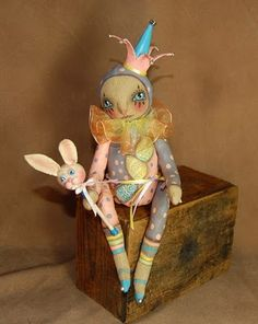Rainbow pastel harlequin doll and her bunny rabbit baton