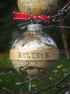 Glass Ornament filled with strips of burlap.