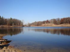 """Saginaw Valley State University photography student Amanda Abraham submitted this photo taken of Lake O'Brien in Holly. Abraham wrote: """"We love this lake and I wanted to show you its beauty in the early fall. I took this photograph in 2010. This property means family to me."""""""
