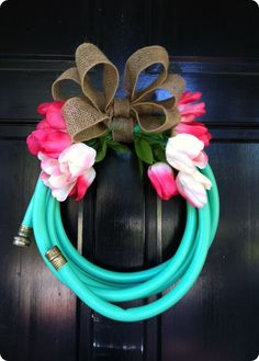spring garden hose wreath...well this is one way to get the hose off the ground. Garden shed