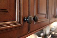 Dark bronze pull on medium dark cabinets
