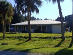 Peaceful 3 Acers of rural Charlotte County.  Conveniently located close to Fort Myers 12 Miles to down town Punta Gorda and only 10 minutes to I-75.  Great view with sliders to the screened in lanai with plenty of room for a pool.  Seperate workshop with electric water shed and a large carport.  This open Acerage has room for a barn stals or RV.  The possiblities go on and on.  This is the privacy youve been waiting for