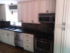 "Pearl Kitchen Cabinets | ""We love the cabinets! We ordered the Pearl door style and they far exceeded our expectations and highly recommend this business."" ~ EMILY MCNUTT"