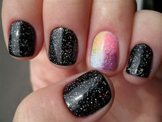 Love this new glittery nail polish. The one bright nail really stands out.  Love the rainbow colors. What do you think?