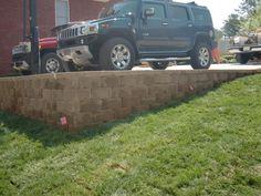 retaining wall below driveway