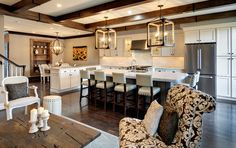 chandeliers, white leather nailhead trim bar stools...