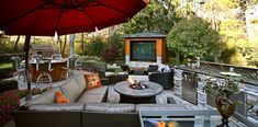 Sporty outdoor lounge with outdoor speakers and fire pit for movie watching outdoors!