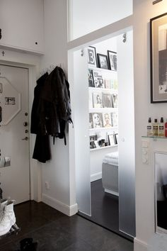 interior design, glass doors, frosted glass, white walls, shelves, pocket doors, black white, foyer, sliding doors