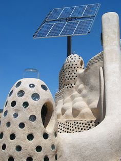 Earthship home: solar panels for energy, recycle glass for day light.