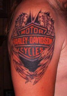 winged harley davidson tattoo on right shoulder