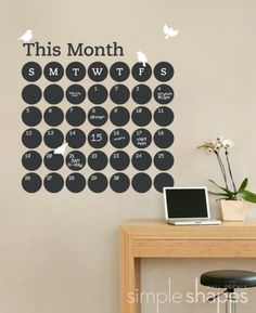 chalkboard calendar - cut out circles from chalkboard fabric; This Month is vinyl; can attach to wall with double-sided tape