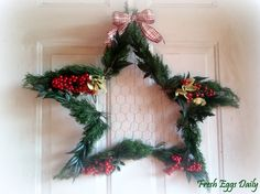Fresh Eggs Daily: Christmas Star Wreath Made from Coat Hangers