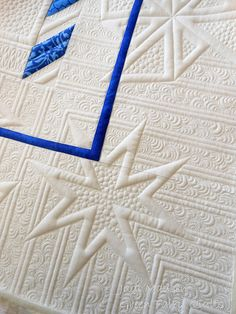 This border design just makes me happy!  Kimberly Einmo's quilt, my quilting.