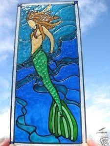 Mermaid in seaweed ocean nautical stained glass window. $25.00, via Etsy.