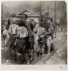 6 August 1945 - Dazed survivors huddle together in the street ten minutes after the atomic bomb was dropped on their city, Hiroshima.