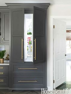 love this cabinet color and hardware.