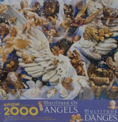 Love the angels on this 2000-piece Multitude of Angels Springbok jigsaw puzzle. #springbok #angels #ck