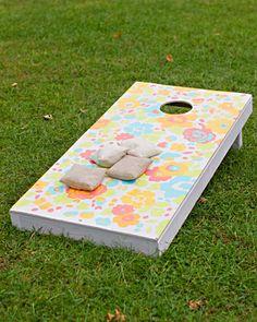 A custom cornhole game for a casual spring reception