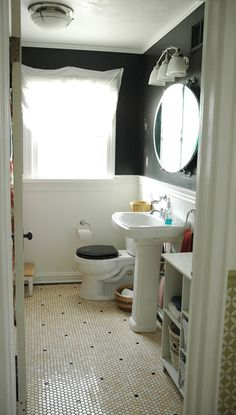 I was always thinking a light colored paint in the bathroom.... but this black really makes me think about going DARK!