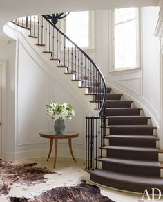 To soften the formality of a North Carolina entrance hall, designer Russell Groves simplified the balusters and installed a sisal on the steps