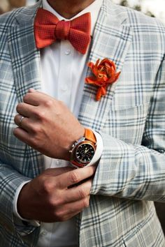 Light grey plaid jacket, white shirt, orange bow tie