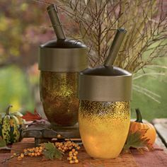 Add an artful acorn to your Thanksgiving table. To turn the decoration into a light, add an electric candle. Avoid using lit candles or votive candles in the enclosed space.