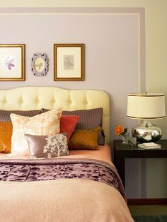 This painted wall treatment helps this pretty headboard to stand out.