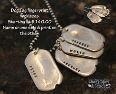 My husbands dog tag fingerprint necklace set of our 4 boys.