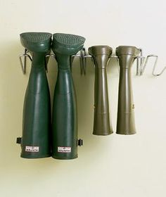 A neat way to store clunky rain boots off a closet floor: a metal shoe rack that affixes to the wall.