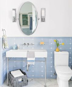 Powdery blue vintage-inspired tile wraps the walls of a graceful master bath addition.| Photo: Patricia Lyons | thisoldhouse.com blue, bath remodel, bath vanities, wall tiles, patricia lyon, master baths, subway tiles, kid bathrooms, vintage style