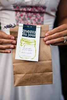 Another way to serve food at a picnic wedding is in brown paper bags with the menu attached with a sprig of lavender (which also acts as an insect repellant)! This way, guests can easily read what is in each bag and choose the lunch of their choice.