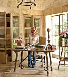 Office of Chateau Domingue has 18th c French doors and stone barrel-vaulted ceiling