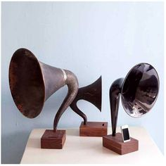 The iVictrola is crafted from hand-carved wood and vintage horns from old phonographs or radios. It's beautiful, electricity-free and costs an arm and a leg.
