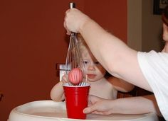 Use a wire whisk to dye eggs...very clever!