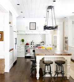 awesome white kitchen...love the light!